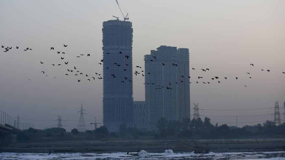 Birds fly over the heavily polluted waters of the Yamuna River, at Kalindi Kunj in New Delhi, India, on Thursday, October 8, 2020.