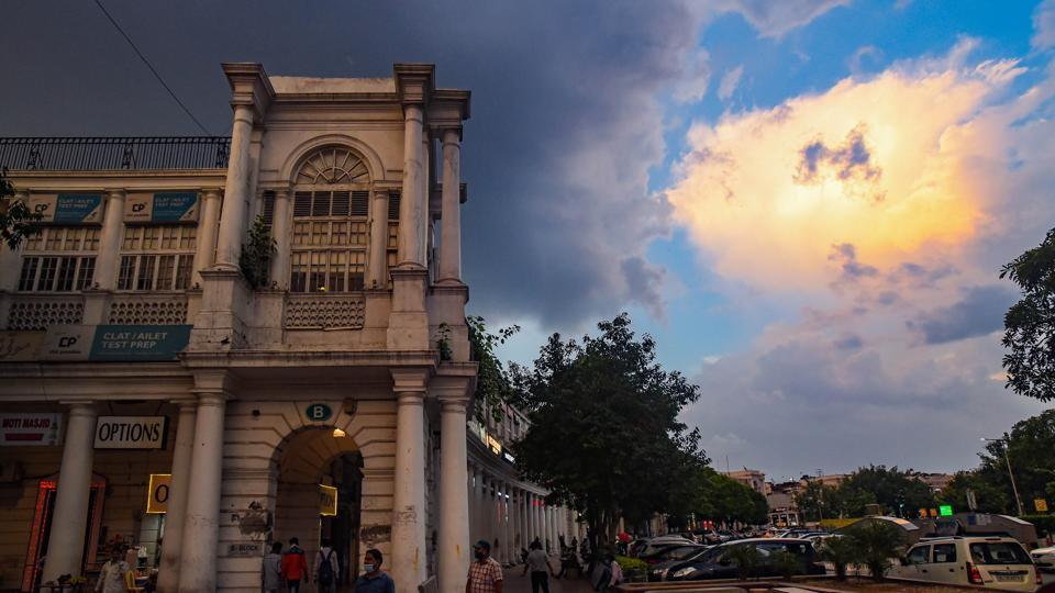 A view of the Connaught Place marketplace on a cloudy evening in New Delhi, India.