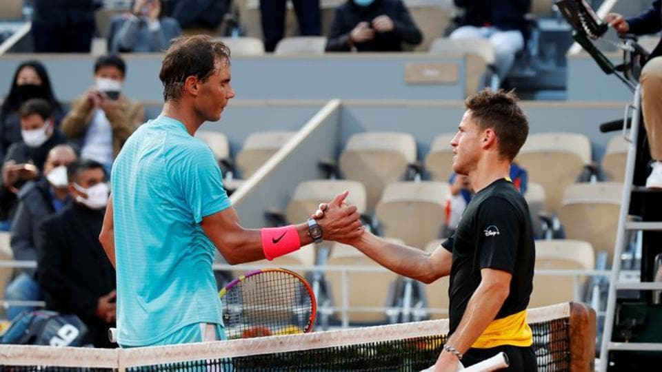 Tennis - French Open - Roland Garros, Paris, France - October 9, 2020 Spain's Rafael Nadal shakes hands with Argentina's Diego Schwartzman after winning the semi final match REUTERS/Charles Platiau