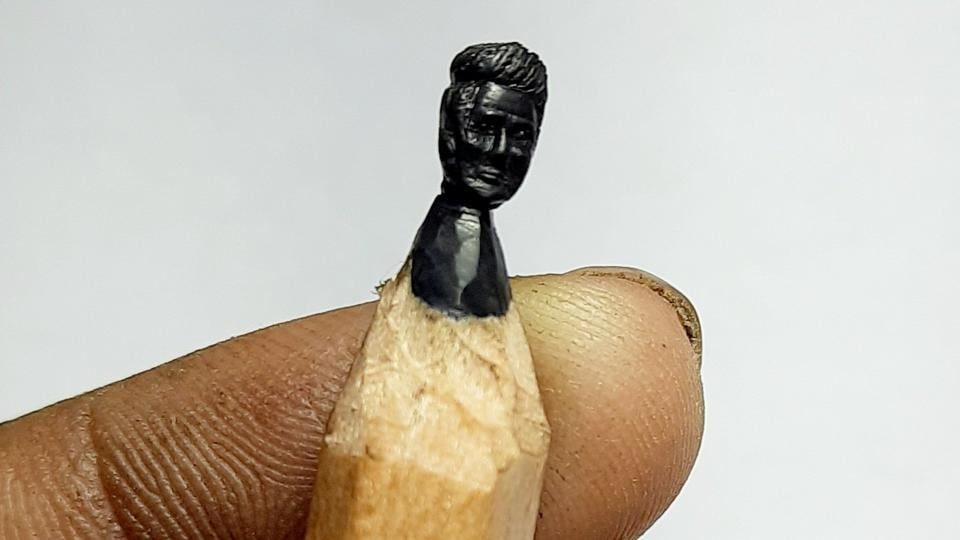 The image shows the artist's creation - Sonu Sood's face on a pencil tip.