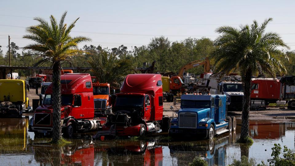 Trucks are seen in a flooded lot after Hurricane Delta, in Lake Charles, Louisiana, US
