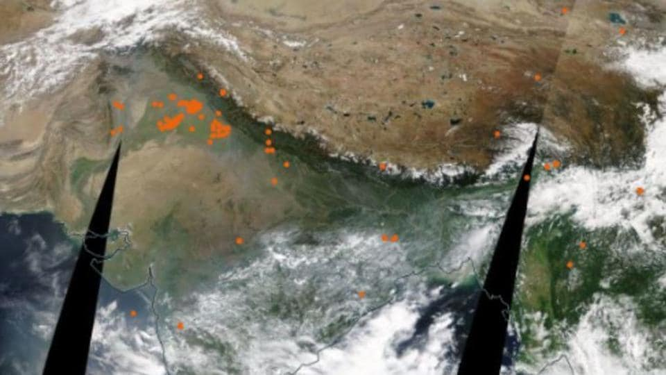 NASA satellite images from October 10, showing farm fires in north India.