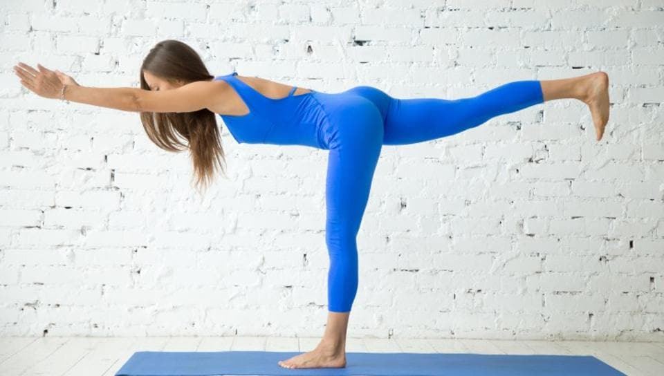 Warrior III pose activates your core in no time.