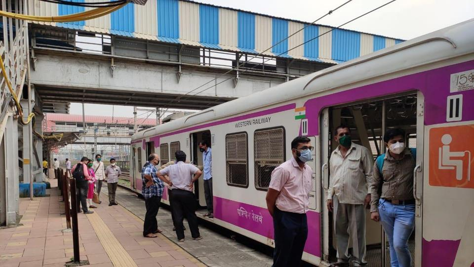 Commuters waiting for railway to commence at Prabhadevi station after power failure in many parts of Mumbai on Monday.