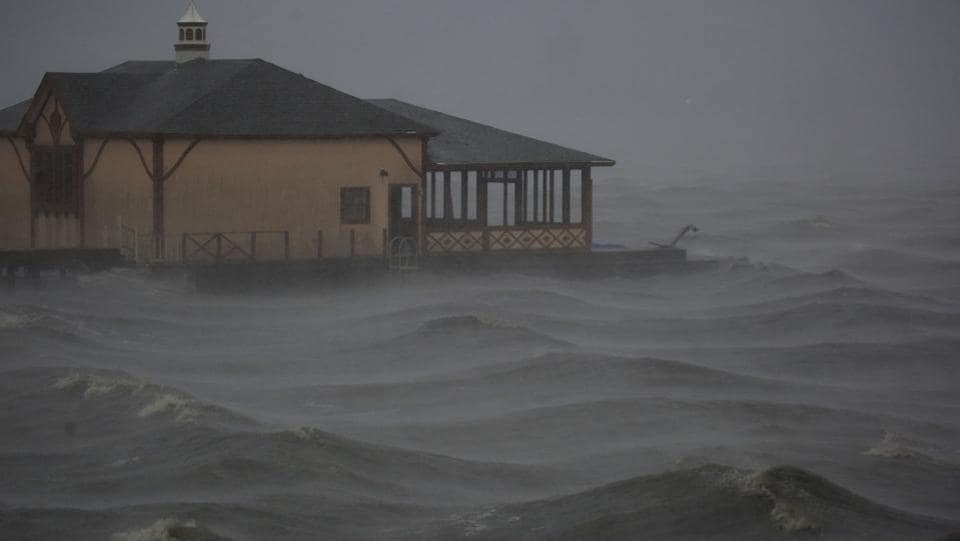 Storm surge moves past a boathouse as Hurricane Delta makes landfall in Lake Charles, Louisiana on October 9.  Two days later, the storm had been downgraded to a post-tropical cyclone over the southern Appalachians, but still posed a heavy rainfall threat, the US National Hurricane Center said. (Luke Sharrett / Bloomberg)