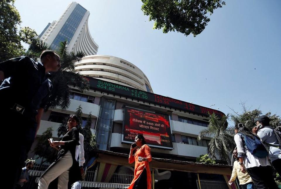 People walk past the Bombay Stock Exchange (BSE) building in Mumbai.