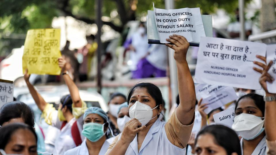 Resident doctors and nurses of Hindu Rao Hospital continue to protest against Delhi Government and MCD over alleging salary non-payment over the last few months, in New Delhi on Saturday.