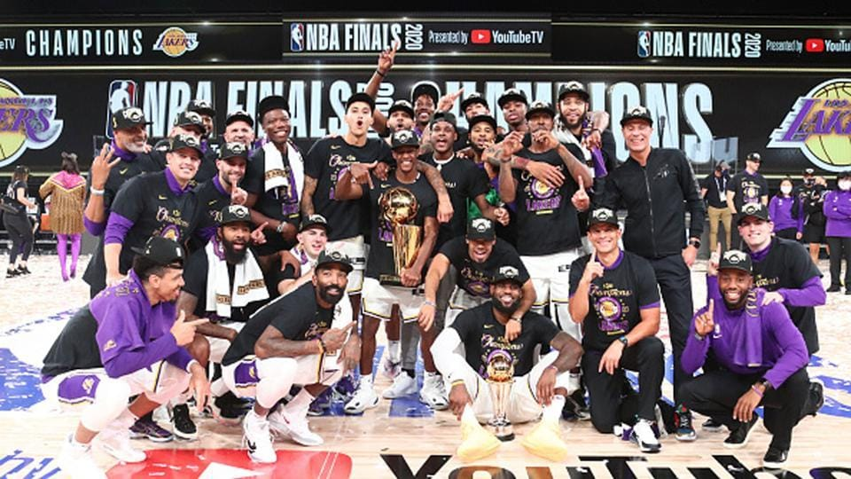 The Los Angeles Lakers poses for a photo together after winning Game Six of the NBA Finals.