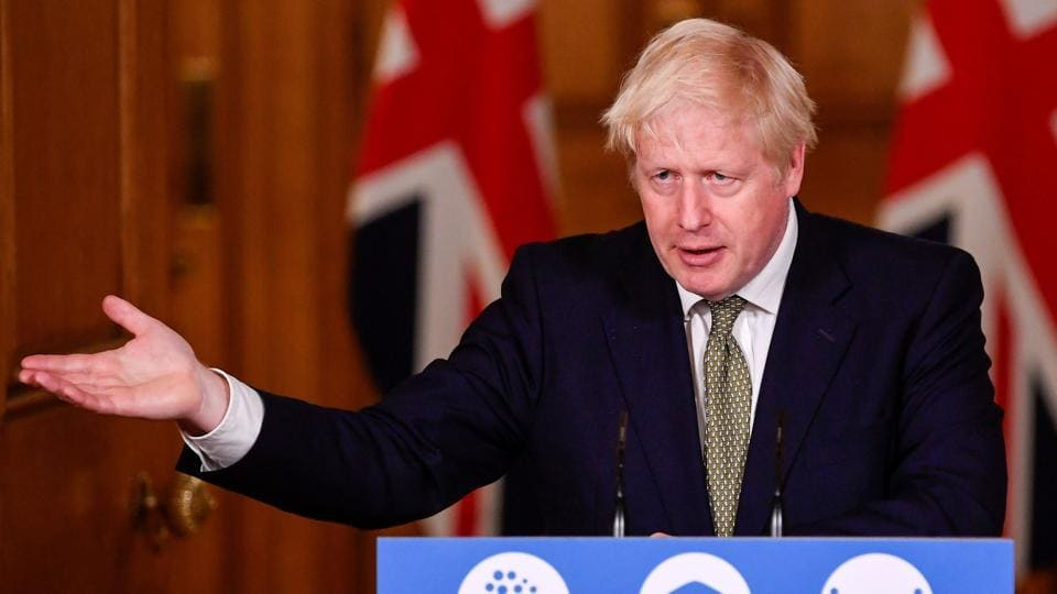 "Britain's Prime Minister Boris Johnson reacts during a virtual press conference at 10 Downing Street in London on October 12. Johnson said the three-level national system was designed to ""simplify and standardise"" a confusing patchwork of local rules, as the country enters a ""crucial phase."" Johnson said hospitals are now filling up with more Covid-19 patients than in March, when he ordered a national lockdown, AP reported. (Toby Melville / AFP)"