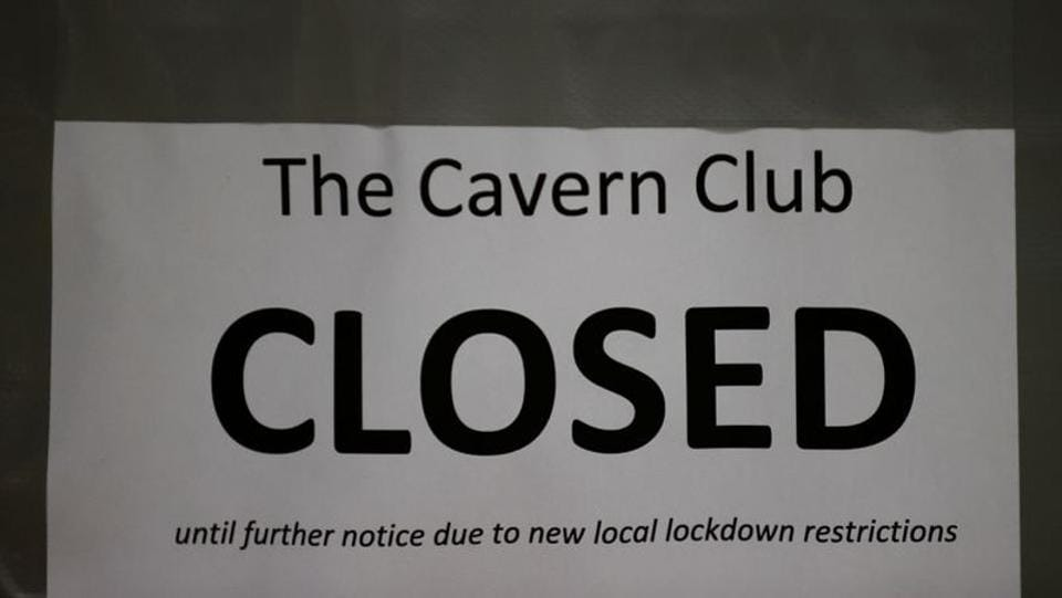 "A public notice hangs outside The Cavern Club in Liverpool on October 12. Areas under the ""very high"" risk category will face restrictions including closing pubs—apart from those that serve meals. (Phil Noble / REUTERS)"