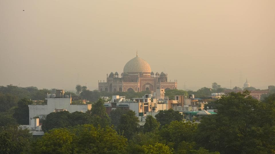 Humayun's Tomb seen enveloped in mist seen during early morning hours as air pollution is on the rise, at Nizamuddin, in New Delhi, India, on Saturday, October 10.