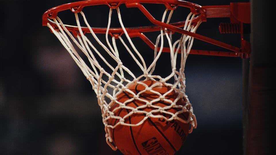 Generic view of a Spalding NBA basketball dropping into the hoop during the FIBA European Basketball Championship.