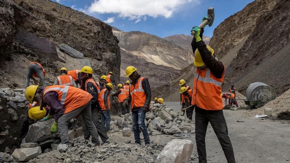 Labourers from the Border Roads Organisation (BRO) work on a highway under construction in the Ladakh region.
