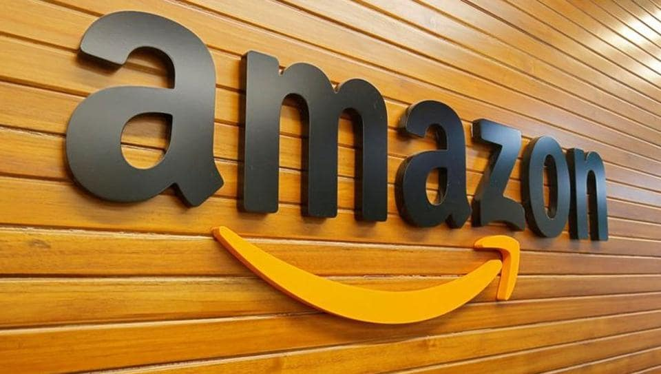 FILE PHOTO: The logo of Amazon is pictured inside the company's office in Bengaluru (REUTERS/Abhishek N. Chinnappa)