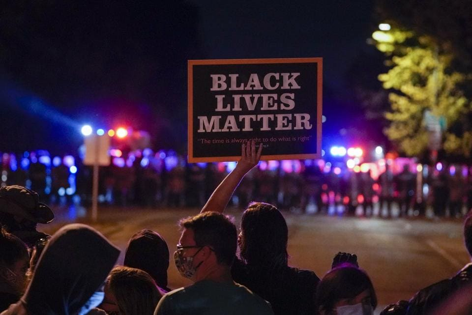 A protest in Wauwatosa, Wisconsin against the February 2 fatal shooting of 17-year-old Alvin Cole at Mayfair Mall. (AP Photo/Morry Gash)