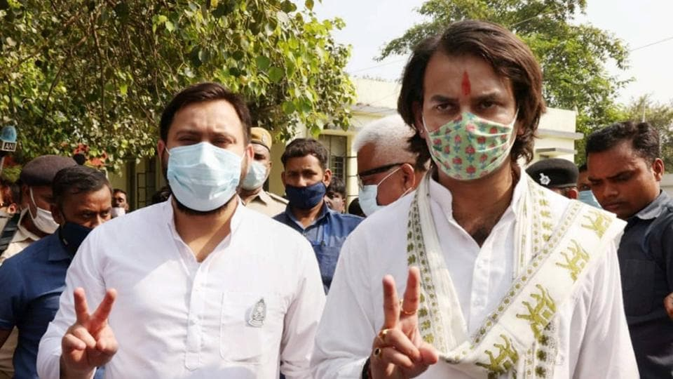 RJD candidate Tej Pratap flashes victory sign along with his brother and party leader Tejaswi Yadav after filing his nomination papers from Hassanpur assembly seat ahead of the Bihar Assembly polls, in Samastipur district on Tuesday.