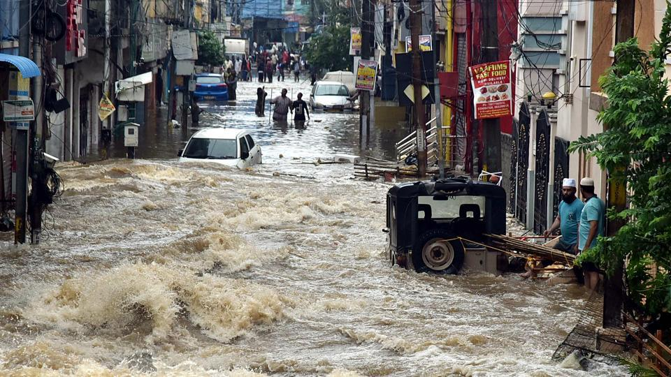 Floodwater gushes through a street following heavy rains at Falaknuma in Hyderabad on October 14.  Hyderabad recorded 192 mm rain on October 13 which is the highest ever October rain recorded in over 100 years. The all-time record for Hyderabad in October was 117.1 mm on October 6, 1903, according to IMD. (ANI)