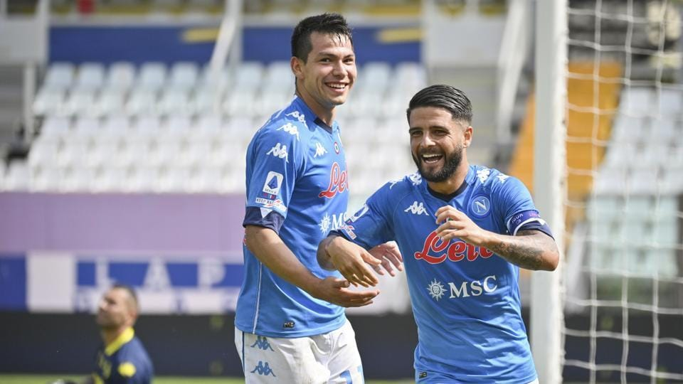 Napoli's Lorenzo Insigne, right, celebrates with teammate Hirving Lozano after scoring his side's second goal during the Serie A soccer match between Parma and Napoli at the Ennio Tardini stadium.