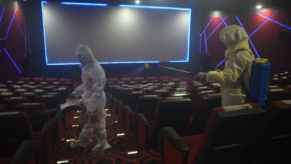 Workers disinfect Ajanta Cinema as part of preparations to reopen cinema halls and multiplexes nationwide amid the coronavirus pandemic in Kolkata on Wednesday.