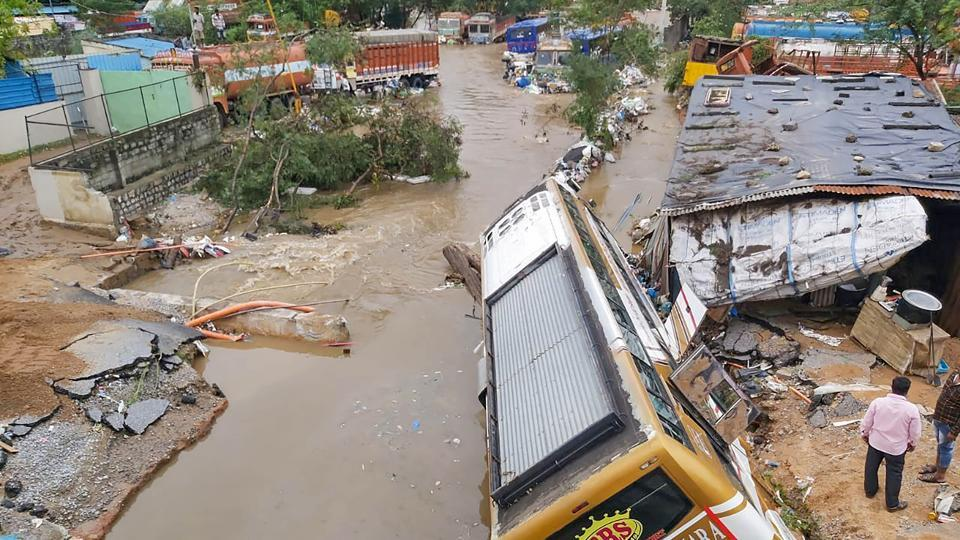 A bus damaged after a road caved-in following incessant rainfall across the state at Gaganpahad-Shamshabad Road near Hyderabad on October 14. According to the Indian Meteorological Department (IMD), a depression over western parts of Telangana, about 50 kilometers west of Hyderabad has caused incessant rains in Hyderabad and surrounding areas. (PTI)