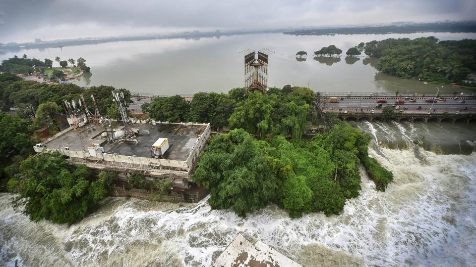 The swollen Hussainsagar tank following incessant rainfall on October 14. Thirty cars and trucks were reported washed away due to water bodies overflowing in the city, district collector Amoy Kumar said. (PTI)