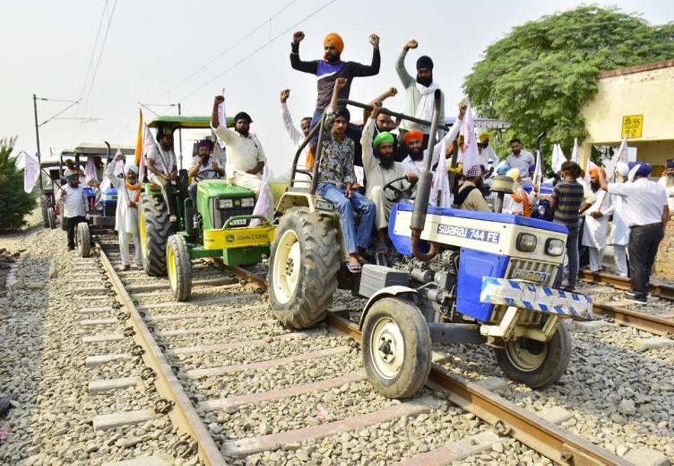 Farmers blocking the rail track near Devi Dass Pura near Amritsar. The farmers have denied that their agitation is causing any shortage of coal for thermal power plants and fertilisers for the rabi  sowing season.