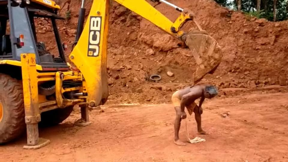 The man using the JCB excavator to scratch his back.