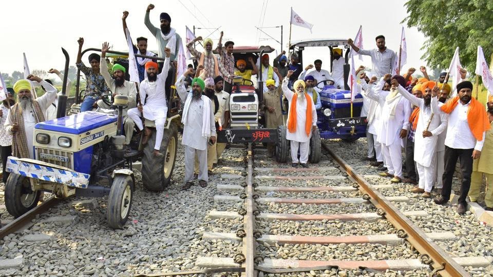 Farmers ride tractors on railway tracks during the ongoing 'Rail Roko' agitation against the Farm bills in Punjab.