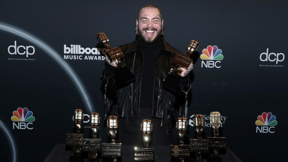 Post Malone poses with awards at the 2020 Billboard Music Awards broadcast on October 14, 2020 at the Dolby Theatre in Los Angeles.