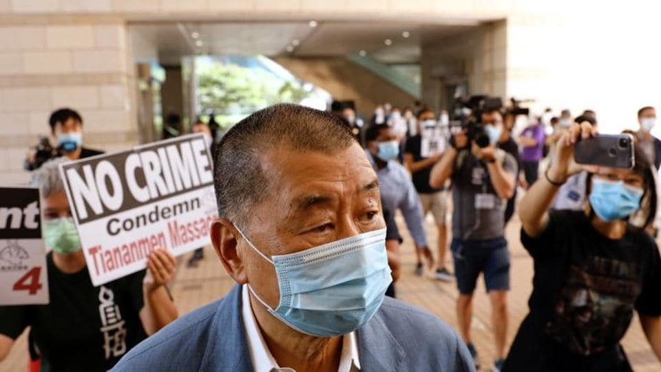 Media mogul Jimmy Lai Chee-ying, founder of Apple Daily arrives at West Kowloon Courts to face charges related to an illegal vigil assembly commemorating the 1989 Tiananmen Square crackdown, in Hong Kong.
