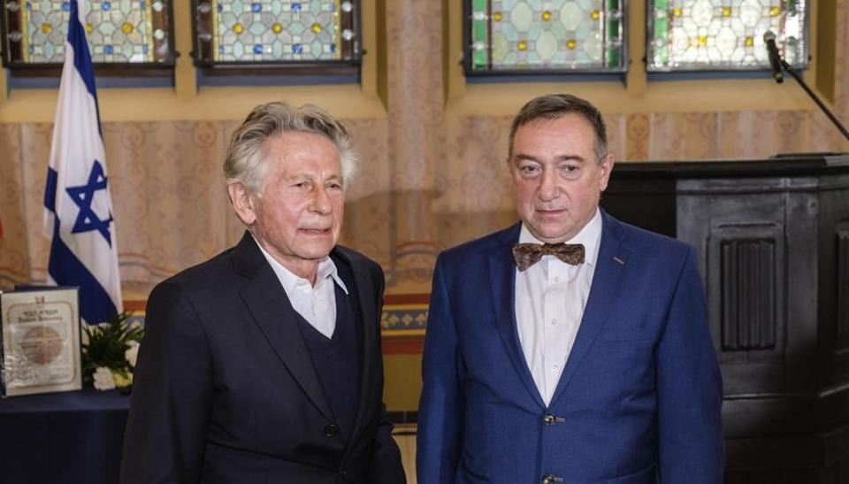 Oscar-winning filmmaker Roman Polanski, left, poses for the media with Stanislaw Buchala, right, who received the Israeli distinction of the Righteous Among the Nations on behalf of his late grandparents, Stefania and Jan Buchala.