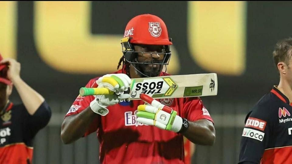 Chris Gayle points to The Boss sign.