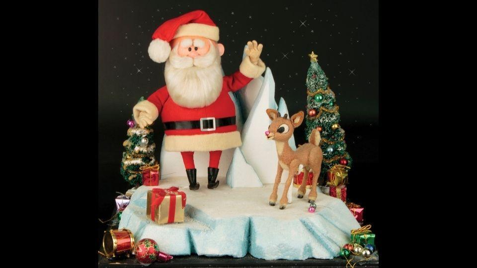 This image released by Profiles in History shows a Santa Clause and Rudolph reindeer puppet.