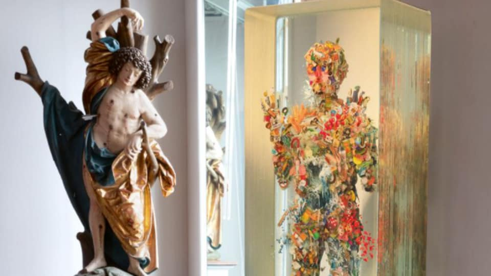 In Hester Diamond's apartment: Jorg Lederer's Saint Sebastian (left), estimated from $600,000 to $1.2 million, and Dustin Yellin's Small Figure No. 48 .