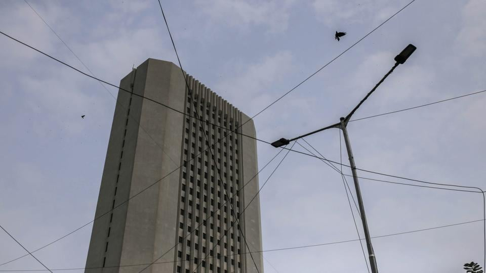 A bird flies past power cables near the Reserve Bank of India (RBI) headquarter building in Mumbai.