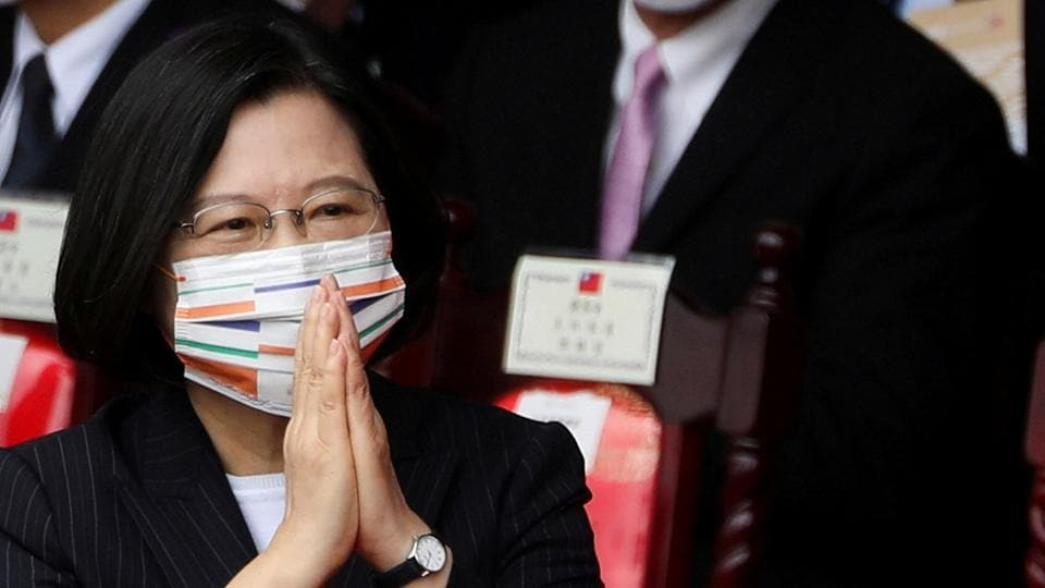 Taiwan President Tsai Ing-wen greeting the crowd during National Day celebrations in front of the Presidential Building in Taipei, Taiwan, October 10, 2020.