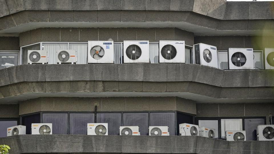 Air conditioners installed at a building near Jhandewalan, in New Delhi (Photo by Biplov Bhuyan/ Hindustan Times)
