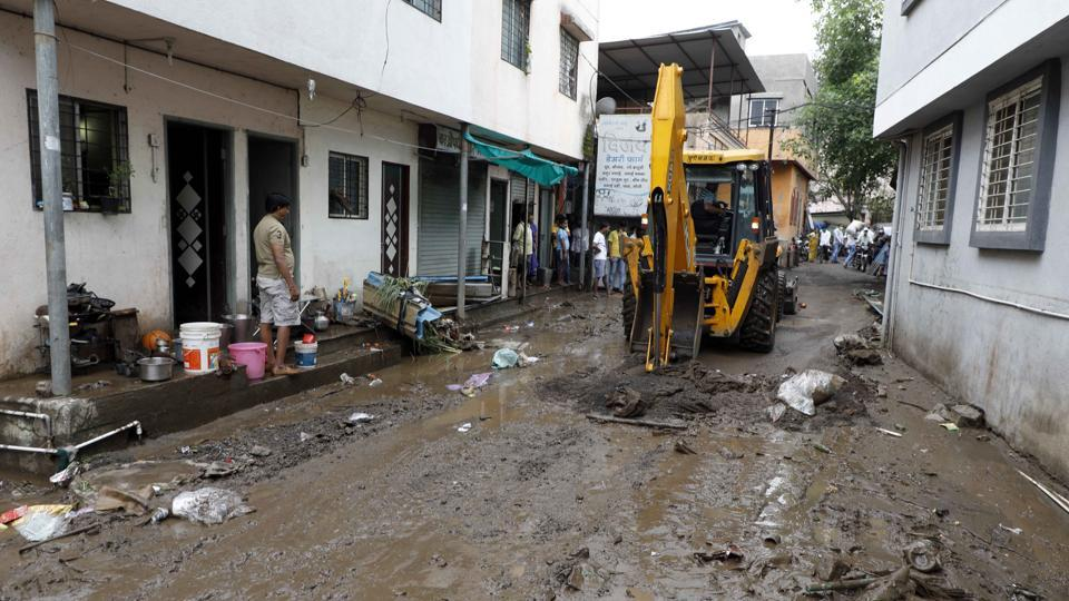 A JCB machine was called in by the civic body to clear garbage and mud after a water pipeline burst, causing inconvenience to residents at Katraj Navin Vasahat.