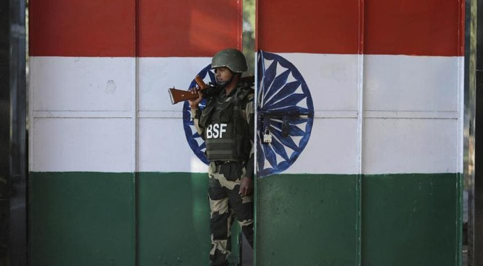 An Indian Border Security Force soldier walks through a gate painted with the Indian flag at the India-Pakistan border at Suchet Garh in Ranbir Singh Pura, about 27 kilometers south of Jammu, India, Thursday, January 23, 2020.