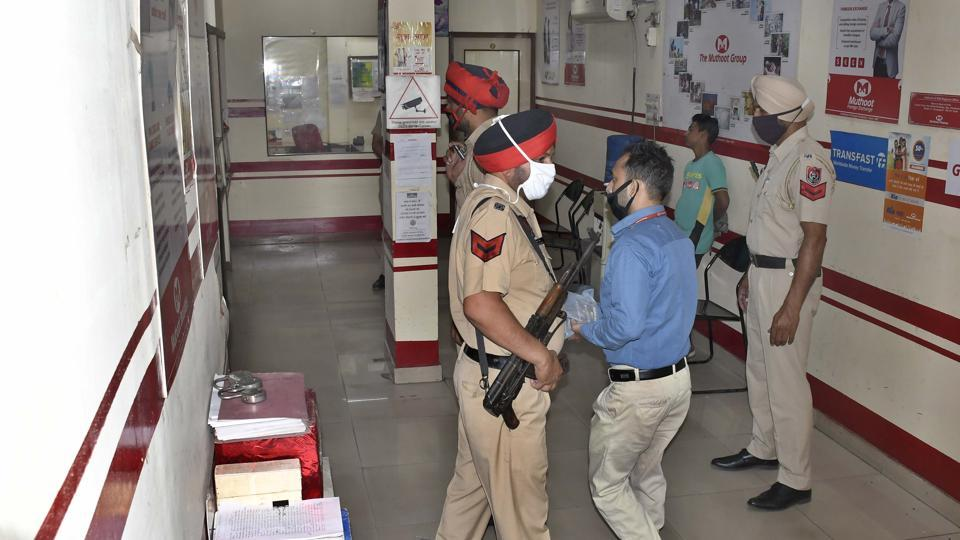 Police at Muthoot Finance store in Ludhiana where a robbery bid was foiled on Friday.