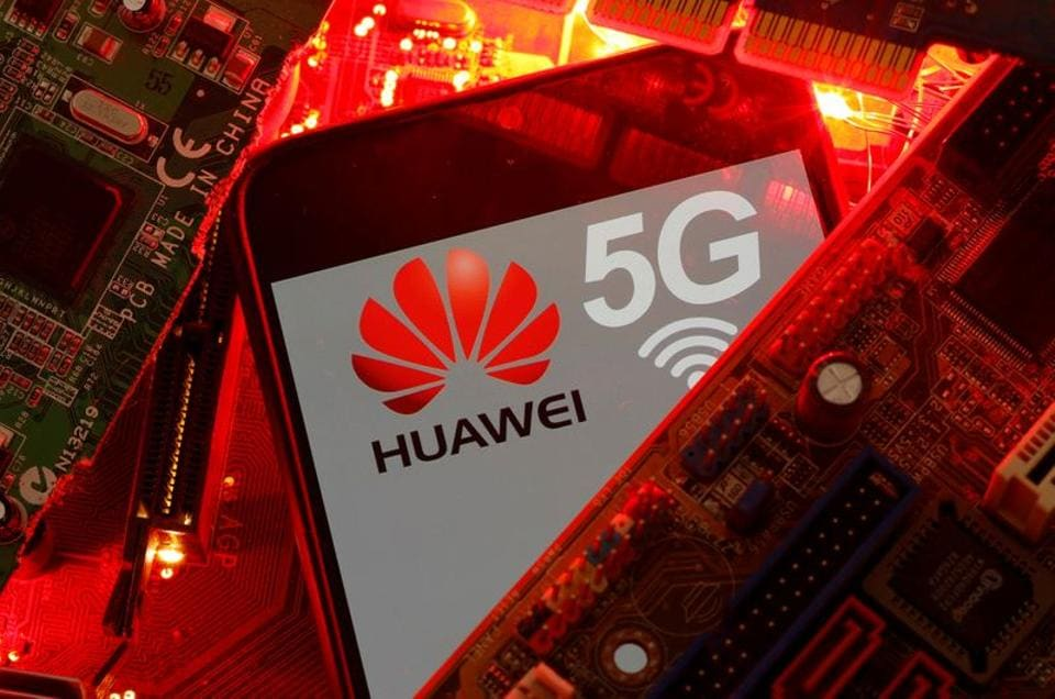 Huawei's position in Europe has come under pressure from a US campaign alleging spying by the network. In Picture - A smartphone with the Huawei and 5G network logo is seen on a PC motherboard