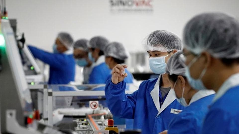 People work in the packaging facility of Chinese vaccine maker Sinovac Biotech, developing an experimental coronavirus disease (COVID-19) vaccine, during a government-organized media tour in Beijing, China.