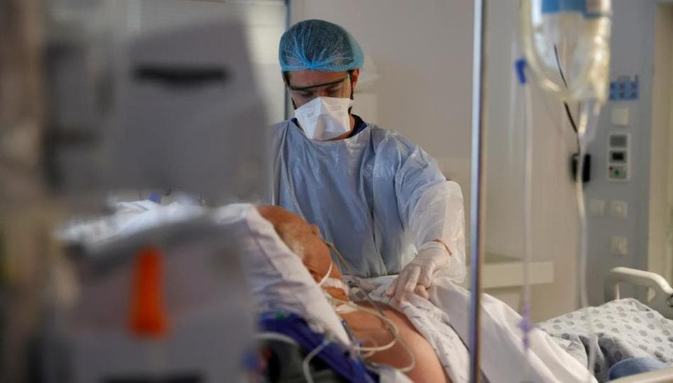 A doctor, wearing a protective mask and a protective suit, works in the Intensive Care Unit where patients suffering from the coronavirus disease are treated at the Bethune-Beuvry hospital in Beuvry, France.