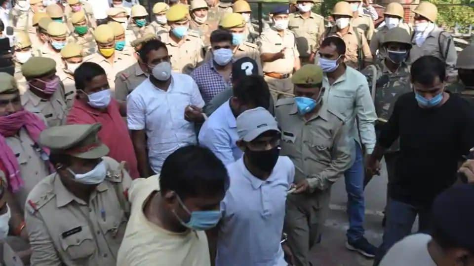 The men charged under UAPA being taken away by Uttar Pradesh Police.