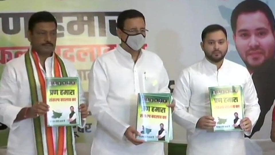 RJDleader Tejashwi Yadav with Congress's Randeep Surjewala at a press conference in Patna on Saturday.