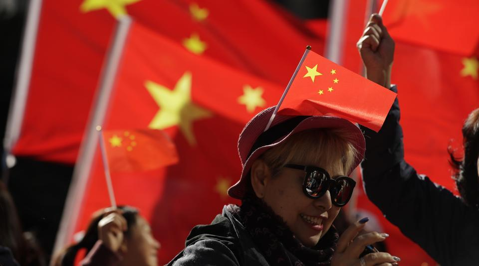 Pro-Beijing supporters wave Chinese national flags during a rally in Hong Kong.