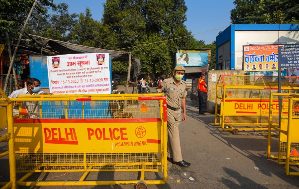 Police personnel outside the Kalkaji Mandir on the eve of Navratri festival as the temple remains closed due to the Covid-19 outbreak in New Delhi.