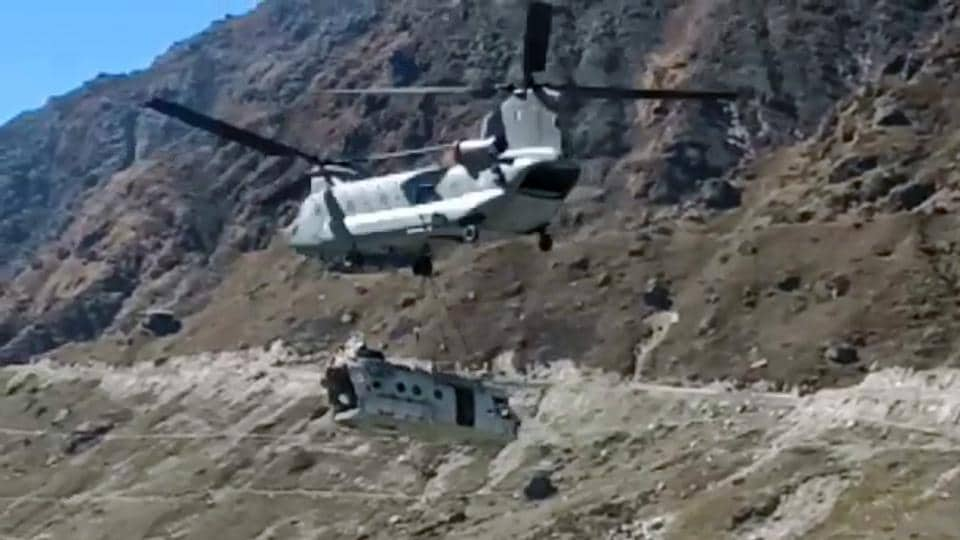 A Chinook helicopter takes off from a helipad in Kedarnath shrine on Saturday, with the debris of Indian Air Force's MI-17 helicopter which had met with an accident in 2018.