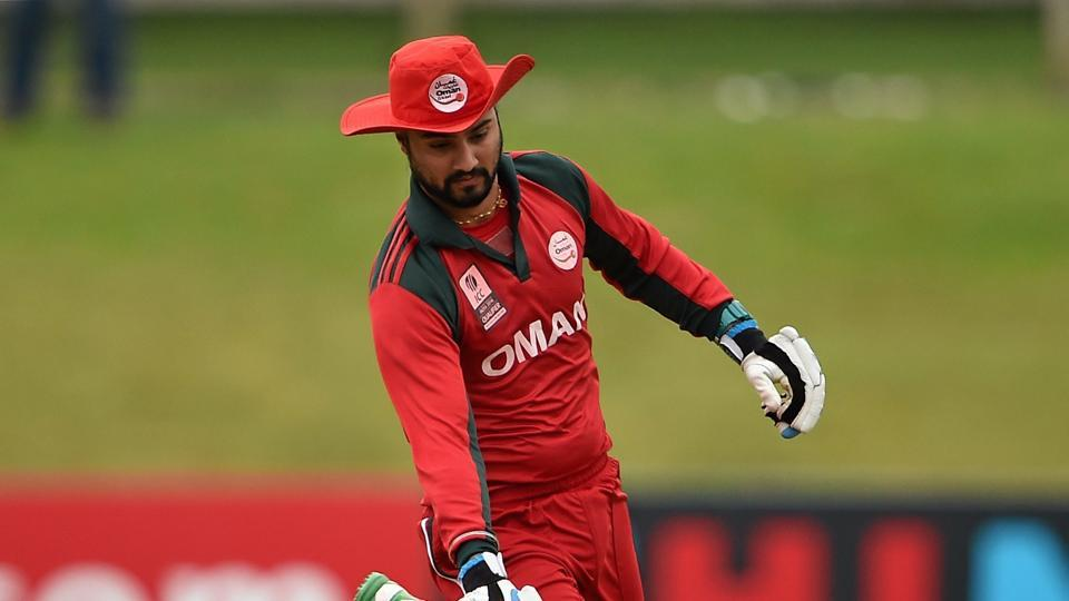Jatinder Singh, Oman, scores a run against Namibia.