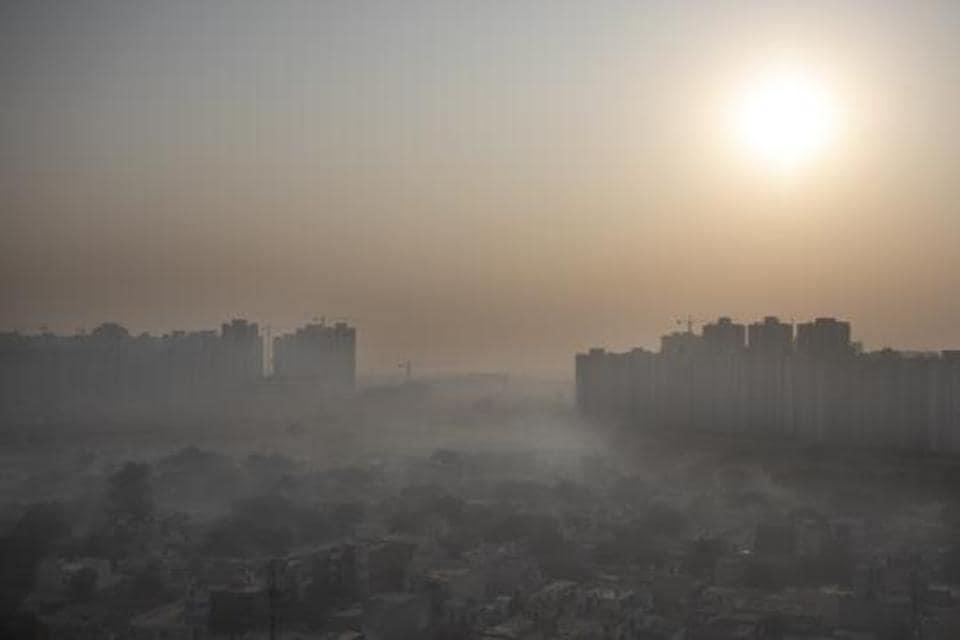 Morning haze envelops the skyline on the outskirts of New Delhi.